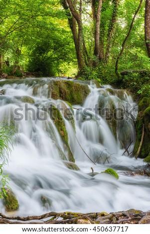 Beautiful waterfall at summer Plitvice Lakes National Park, Croatia, vertical nature background - stock photo