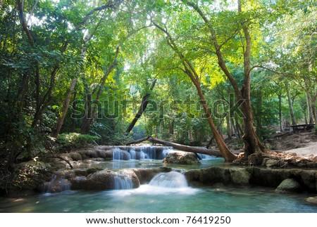 beautiful waterfall cascades in erawan kanachanburi thailand - stock photo