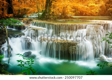 Beautiful waterfall in amazing forest of national park  - stock photo