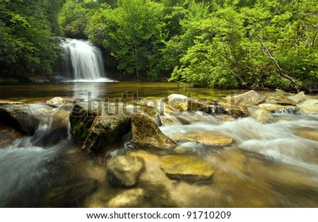 Beautiful waterfall in lush rain forest - stock photo