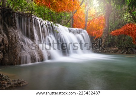 Beautiful waterfall in the forest - stock photo