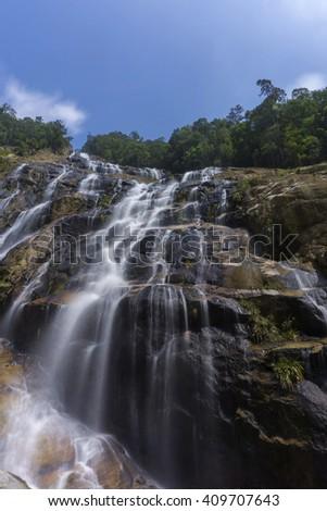 Beautiful Waterfall Located at Chemerong Berembun Langsir, Dungun, Terengganu, Malaysia. Taken with Long Exposure. Soft Focus and Motion Blur due to Long Exposure Shot - stock photo