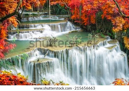Beautiful waterfall n autumn forest - stock photo
