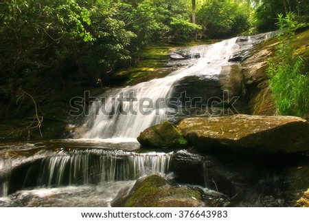 Beautiful waterfall nestled in the lush forests of the Appalachian Mountains of North Carolina - stock photo