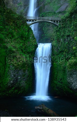 Beautiful Waterfall Separated by Bridge - stock photo