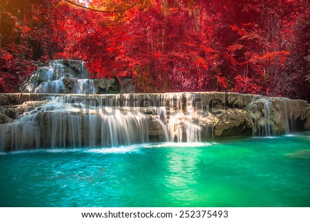 beautiful waterfall with day noon light in fantasy forest, filter colored photo. - stock photo