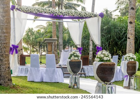 beautiful wedding arch, cabana on beach, outdoor beach wedding - stock photo