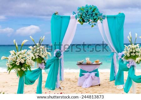 beautiful wedding arch, cabana on sand beach, outdoor beach wedding - stock photo