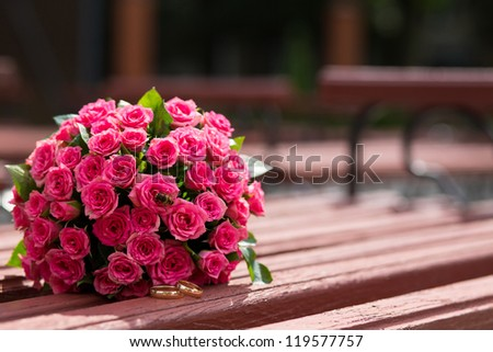Beautiful wedding bouquet and rings - stock photo