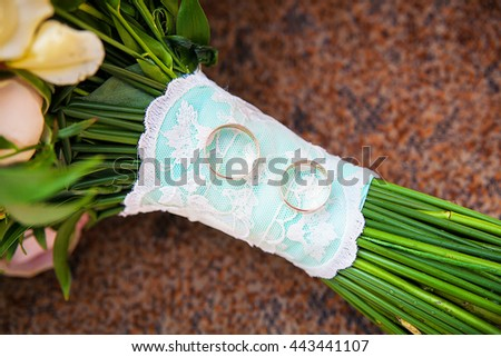 beautiful wedding bouquet and rings close up - stock photo