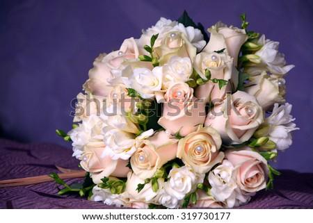 Beautiful wedding bouquet close-up on bright background - stock photo