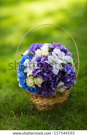 Beautiful wedding bouquet in basket - stock photo