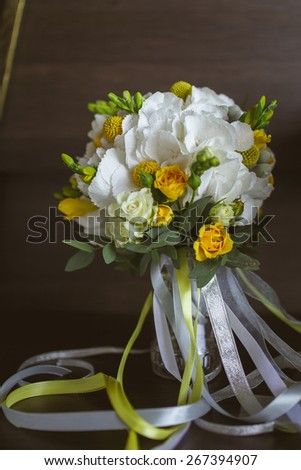 Beautiful wedding bouquet of roses, Craspedia, Hydrangea, Brunia silver flowers - stock photo