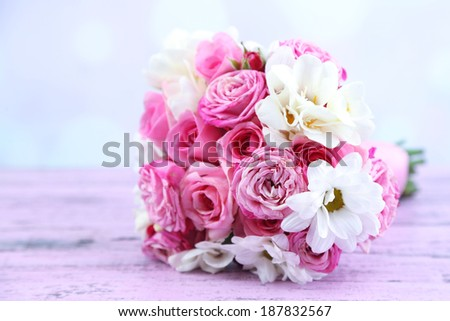 Beautiful wedding bouquet on table on bright background - stock photo