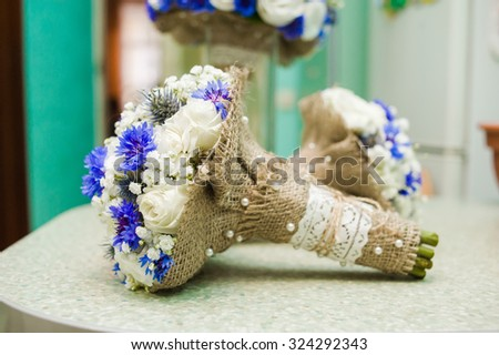 beautiful wedding bouquet the bride and bridesmaids before the wedding ceremony - stock photo