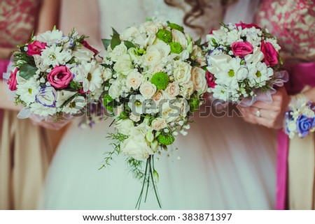 beautiful wedding bouquet with peony, roses, orchids, and green leaves. Tenderness hand made accessory for bride - stock photo