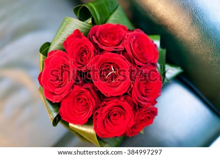 Beautiful wedding bouquet with wedding rings - stock photo