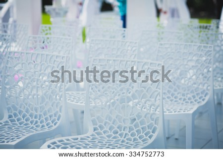 Beautiful wedding ceremony interior and table decor, flower decoration with flowers bouquet, with roses, tulips, peonies, arch - stock photo