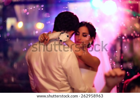 Beautiful wedding dance in soap bubbles, blurred - stock photo