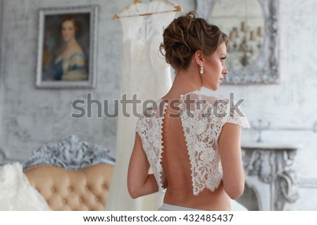 Beautiful wedding dress. Bride in wedding dress. Wedding dress in Paris. Bride in a luxury apartment in a wedding dress. - stock photo