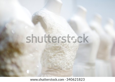 Beautiful wedding dresses on a mannequins - stock photo