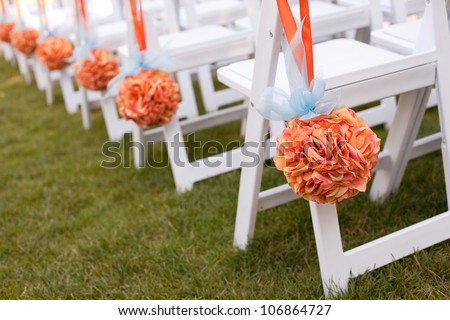 Beautiful Wedding Flower Arrangements Along the Aisle - stock photo