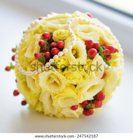 Beautiful wedding flowers bouquet (made of roses) on the white background - stock photo