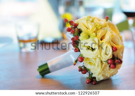 Beautiful wedding flowers bouquet on table - stock photo