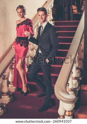 Beautiful well-dressed young couple in luxury interior  - stock photo