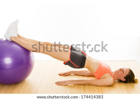 beautiful well trained woman is showing some gymnastics exercises - stock photo