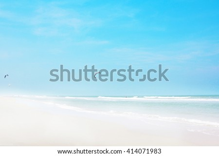 Beautiful white beach and tropical sea with waves. summer sky blur blue background light cool horizon ocean open view window outdoors peaceful water clouds relax landscape travel sunbeam resort scene - stock photo