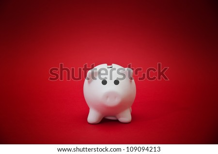 Beautiful white ceramic piggy coin bank, money savings concept - stock photo