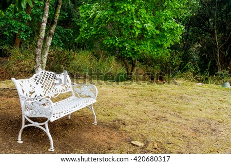 Beautiful white chairs under tree in garden,  Vintage style  - stock photo