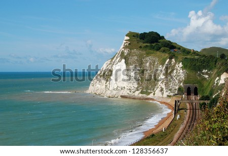 Beautiful white cliffs near Dover, UK and railway - stock photo