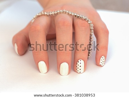 beautiful white female manicure on a white background. nails - stock photo