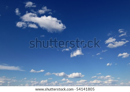 beautiful white fluffy clouds in the blue sky - stock photo