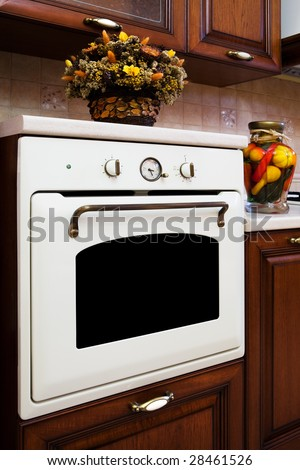 beautiful white gas stove in the modern kitchen - stock photo