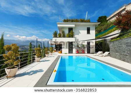 beautiful white house with swimming pool, summer day - stock photo