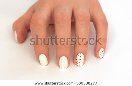 beautiful white nails on a white background - stock photo