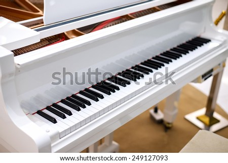 Beautiful white piano - stock photo