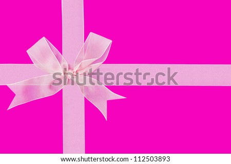 Beautiful white ribbon and gift bow isolated on a pink background - stock photo
