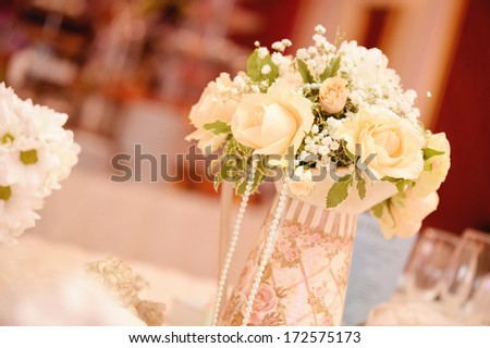 Beautiful white roses on wedding table - stock photo