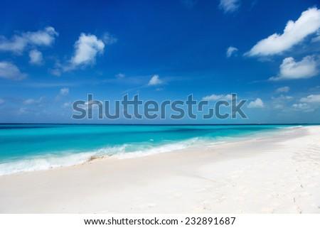 Beautiful white sand beach and Caribbean sea - stock photo