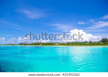 Beautiful white sand beach and turquoise clean water - stock photo
