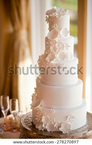 Beautiful white wedding cake - stock photo