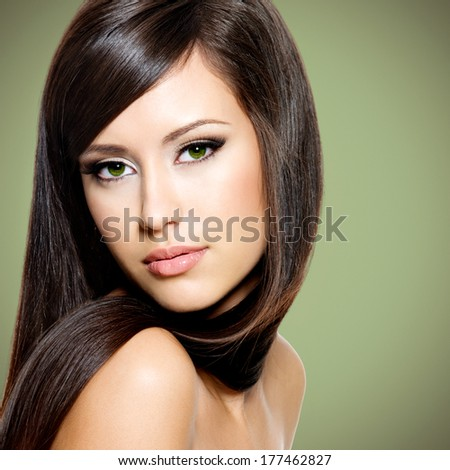 Beautiful white woman with long brown hair posing at studio - stock photo