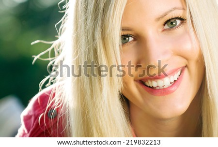 Beautiful wide smile of young fresh woman with healthy white teeth. - stock photo