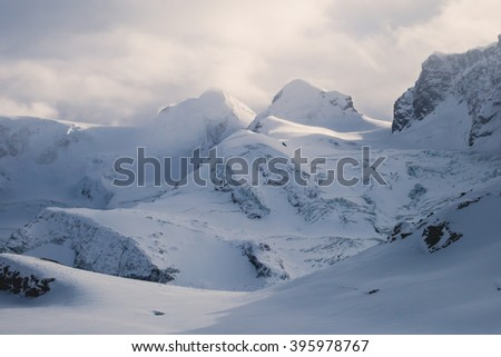 Beautiful wide snow panoramic view of Monte Rosa, mountain massif in the eastern part of the Pennine Alps, between Switzerland and Italy, with peaks Dufourspitze and Lyskamm, near Matterhorn Mountain - stock photo