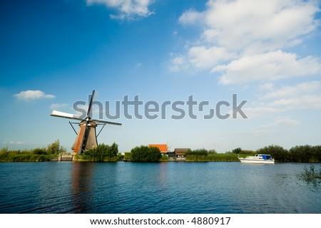 beautiful windmill landscape at kinderdijk in the netherlands - stock photo