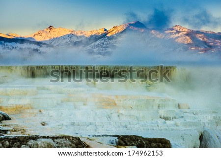 Beautiful Winter Geyser Cascade at Sunset - Yellowstone National Park  - stock photo